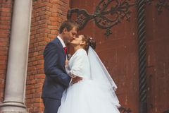 A beautiful bride and handsome groom at church during wedding Stock Photography