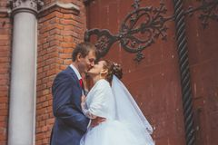 A beautiful bride and handsome groom at church during wedding Royalty Free Stock Images