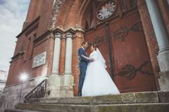 A beautiful bride and handsome groom at church during wedding Stock Image