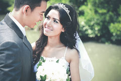 Beautiful bride and handsome groom staring each other Stock Photos