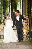 A beautiful bride and handsome groom during wedding in the park Stock Photo