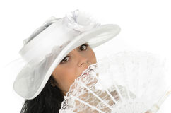 Beautiful bride with hat and fan Stock Images