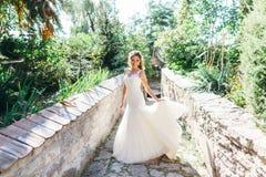 Beautiful bride having fun in nature Stock Photography