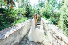 Beautiful bride having fun in nature Royalty Free Stock Photography