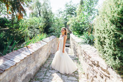 Beautiful bride having fun in nature Stock Photo