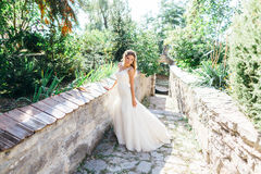 Beautiful bride having fun in nature Royalty Free Stock Image