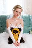 Beautiful bride with her bear-toy Stock Photography