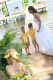 Beautiful bride with her children on dock. Shot of a beautiful bride with her children on dock stock photo