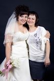 Beautiful bride with her sister on a black backgro Stock Images