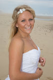A beautiful bride with her wedding dress at the beach Stock Photo