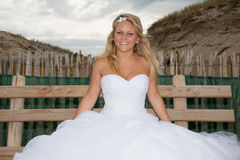 A beautiful bride with her wedding dress Royalty Free Stock Photos