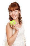 Beautiful bride holding apple. Beautifu  bride holding apple. White background Stock Photos