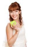 Beautiful bride holding apple Stock Photos