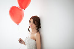 Beautiful Bride Holding Balloons Royalty Free Stock Photography
