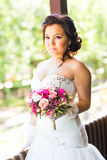 Beautiful bride holding big wedding bouquet Stock Images