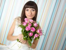 Beautiful bride holding a bouquet Stock Photos