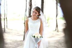Beautiful bride holding a bouquet Stock Photos