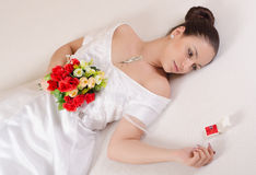 Bride looking at her wedding ring Stock Images