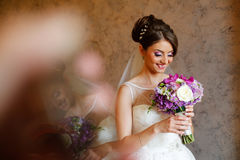 Beautiful bride holding colorful bouquet Royalty Free Stock Photo