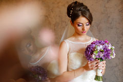 Beautiful bride holding colorful bouquet Stock Photos