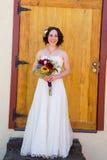 Beautiful Bride Holding Flowers Royalty Free Stock Photo