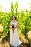 Beautiful Bride Holding Flowers Stock Images