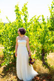 Beautiful Bride Holding Flowers Stock Photography