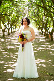 Beautiful Bride Holding Flowers Stock Photo