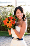 Beautiful bride holding her wedding bouquet Stock Images