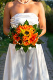 Beautiful bride holding her wedding bouquet. In hand Royalty Free Stock Image