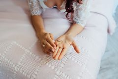 Beautiful bride holding a necklace in her hands Stock Photo