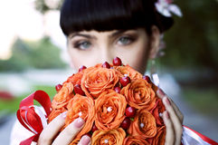 Beautiful bride, holding orange flowers Stock Photos