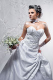 Beautiful bride holding wedding bouquet Stock Image