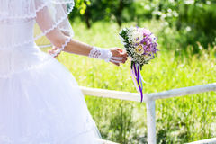 Beautiful bride holding a wedding bouquet Royalty Free Stock Photo