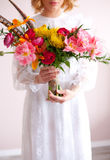Beautiful bride holding wedding bouquet in hands Stock Photos