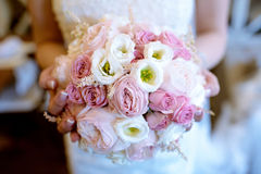 Beautiful bride is holding a wedding colorful bouquet Stock Photography