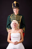 Beautiful bride and hussar Stock Photography
