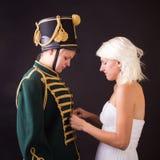 Beautiful bride and hussar Stock Photos