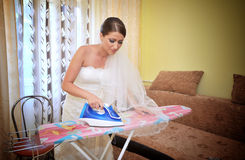 Beautiful bride ironing Stock Photography