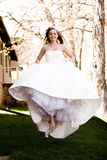 Beautiful Bride Jumping. A beautiful bride jumping in the air royalty free stock photography