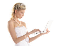 Beautiful bride with laptop stock image