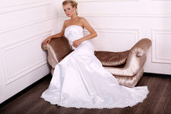 Beautiful bride with long blond hair in elegant dress Royalty Free Stock Photos