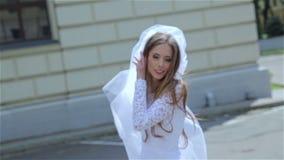 Beautiful bride with long veil. Very beautiful bride with long veil walks HD stock footage