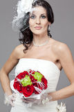 Beautiful bride in long wedding dress. Royalty Free Stock Image
