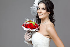 Beautiful bride in long wedding dress. Royalty Free Stock Images