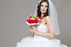 Beautiful bride in long wedding dress. Royalty Free Stock Photos