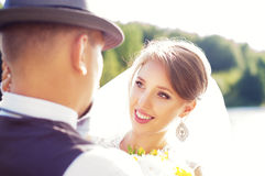 Beautiful bride looking at the groom Stock Photography