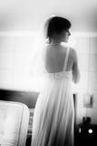 Beautiful Bride looking at mirror Stock Photo