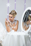 Beautiful bride looking in mirror Stock Photography