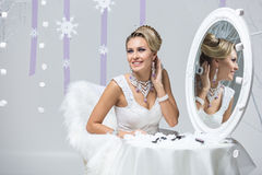Beautiful bride looking in mirror Stock Images